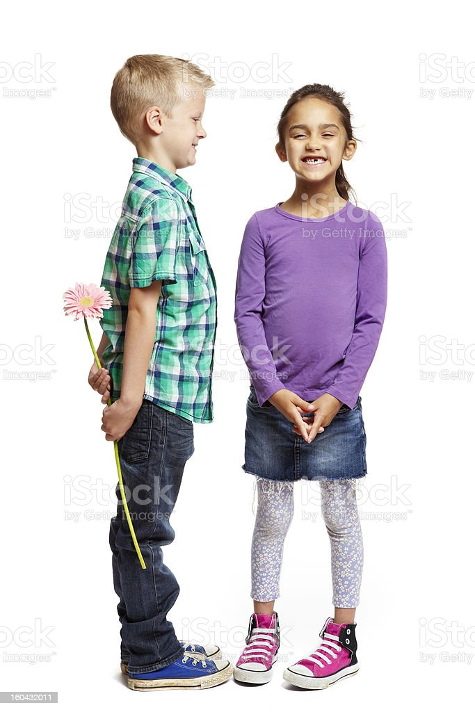 Boy giving pink flower to girl royalty-free stock photo