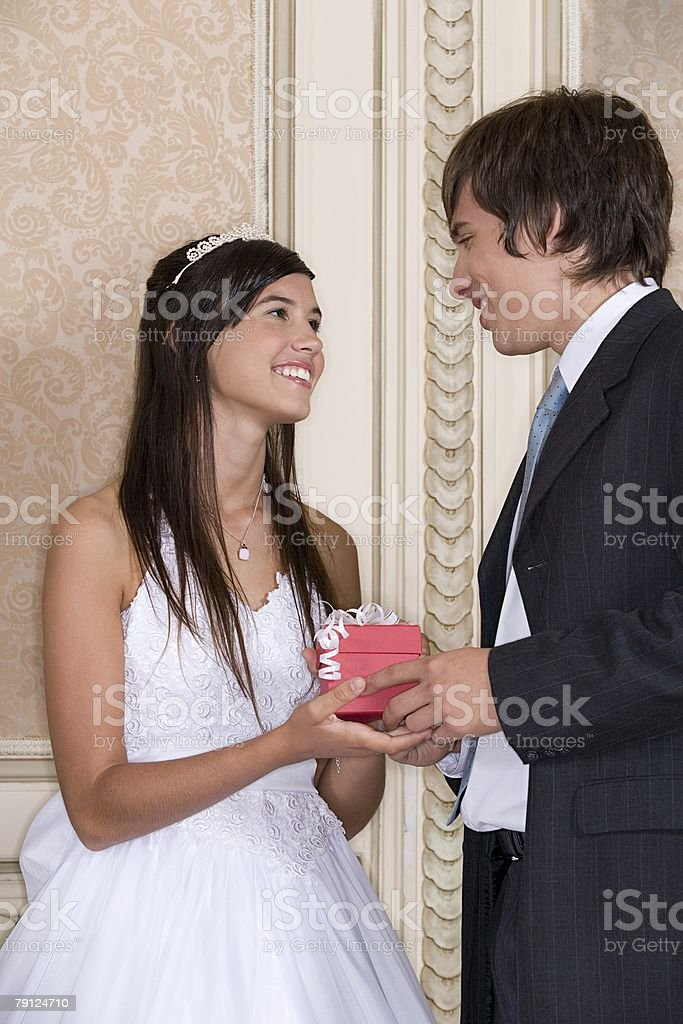 Boy giving quinceanera gift to girl 免版稅 stock photo