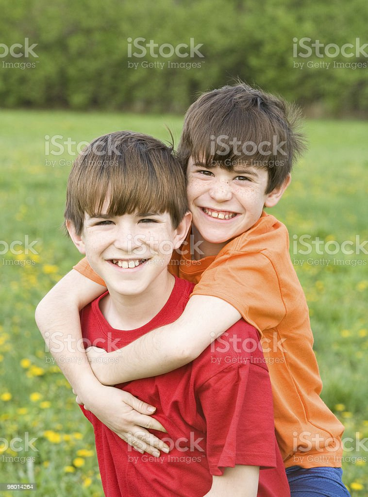 Boy Giving Ride on Back royalty-free stock photo