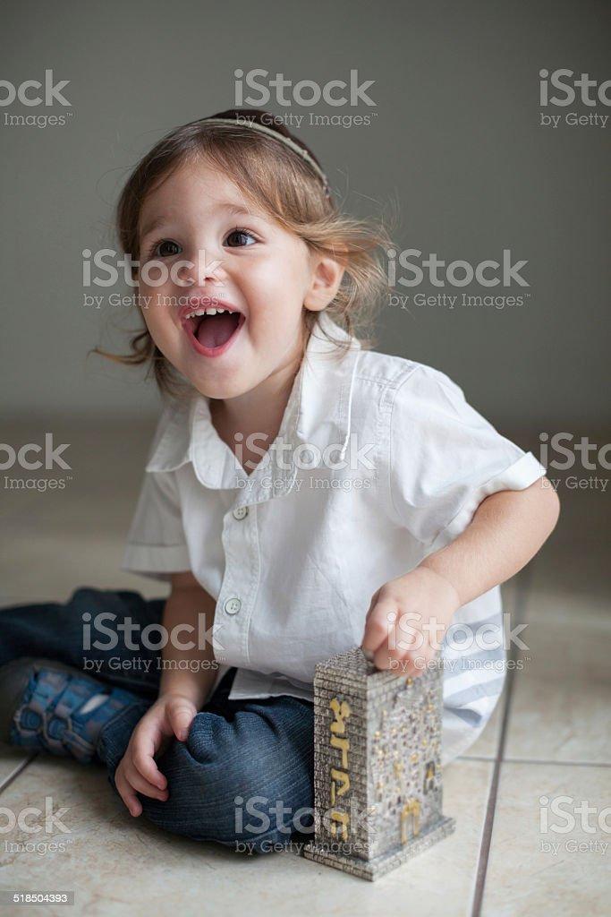 Boy Giving Tzedakah stock photo