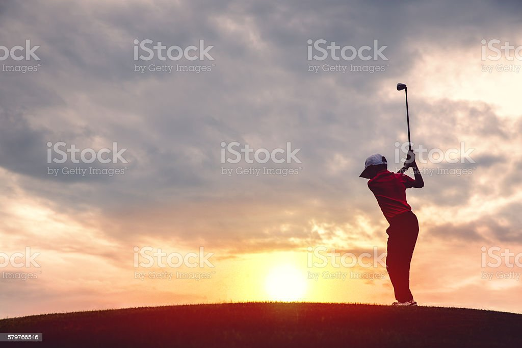 boy golfer silhouette stock photo