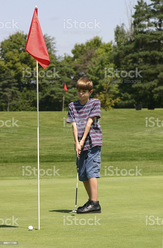 Boy Golfing royalty free stockfoto