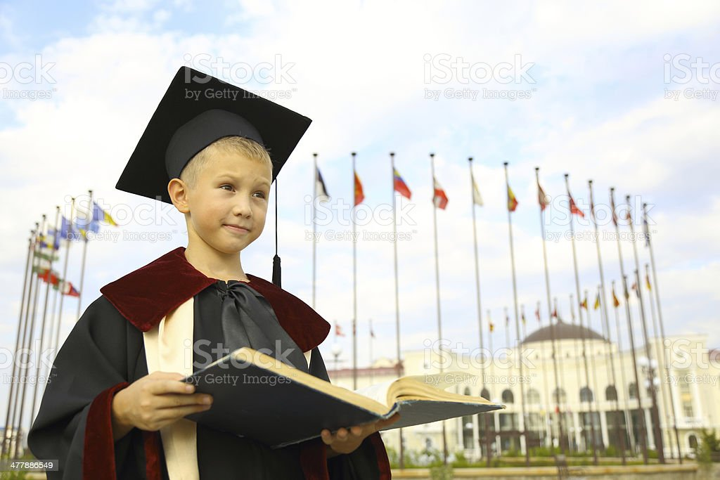 Boy graduate with a book royalty-free stock photo