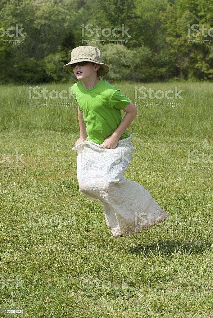 Boy Gunny Sack Race, Elementary School Field Day, High Bounce stock photo
