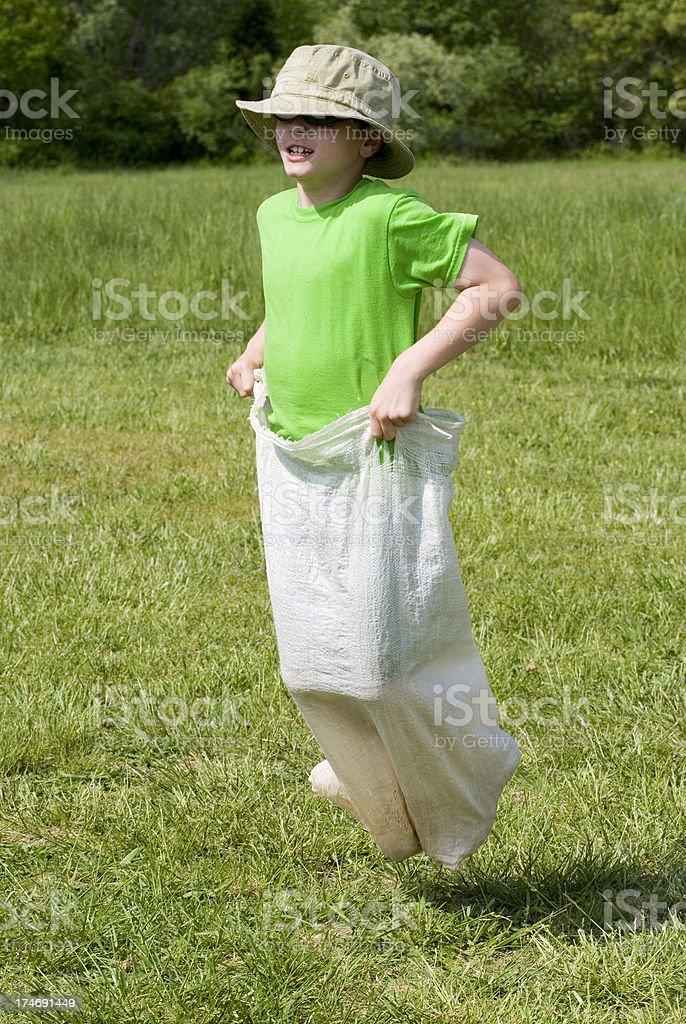 Boy Gunny Sack Race, Elementary School Field Day, Standing Tall stock photo