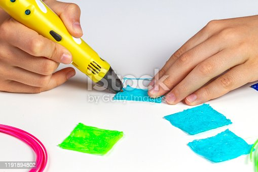 899701486 istock photo Boy hands creating with 3d pen new object 1191894802