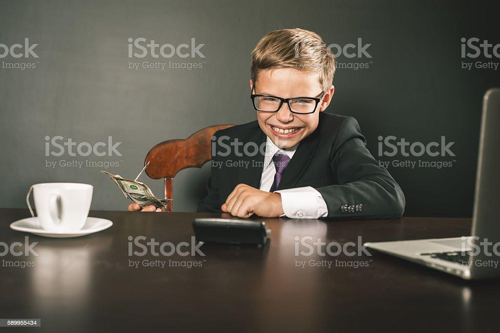 Boy has earned a lot of money stock photo