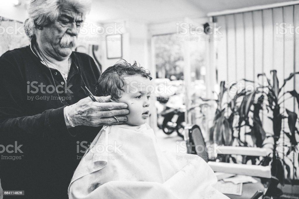 Boy having a haircut stock photo