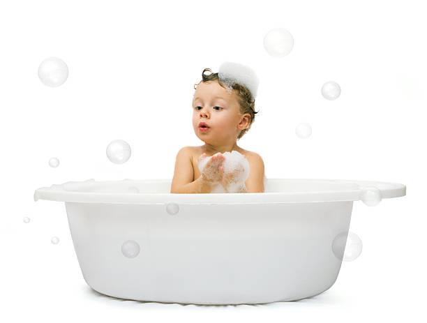 boy having bath stock photo