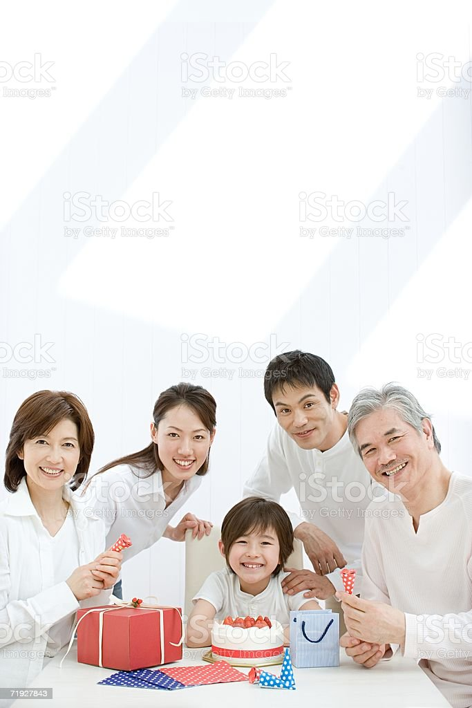 Boy having birthday party with family royalty-free stock photo