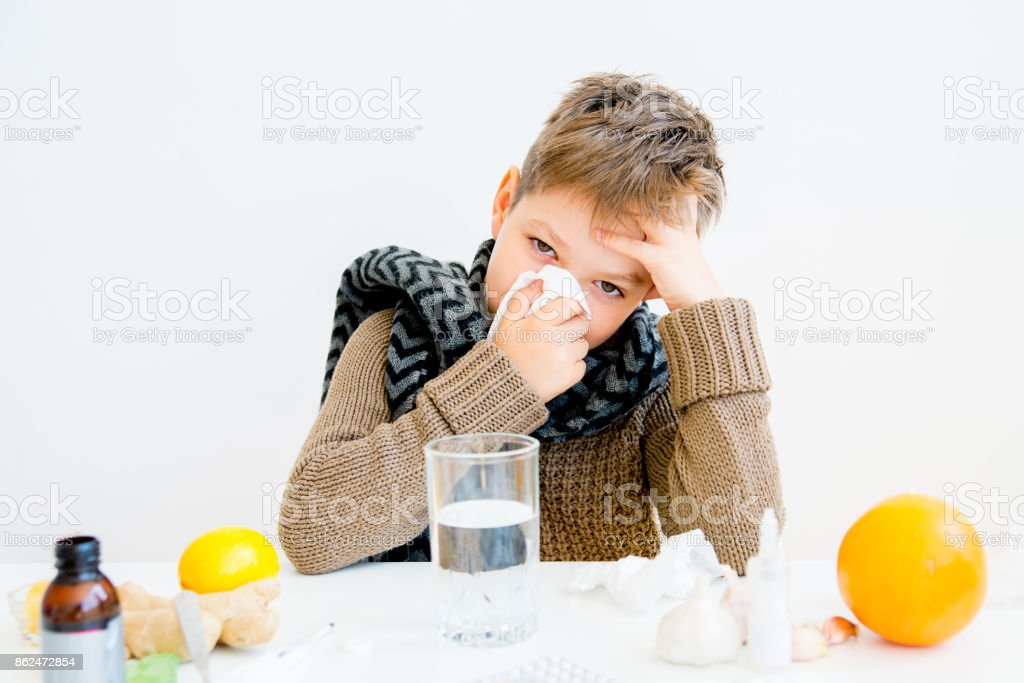 Boy having flu stock photo