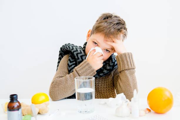 Boy having flu stock photo