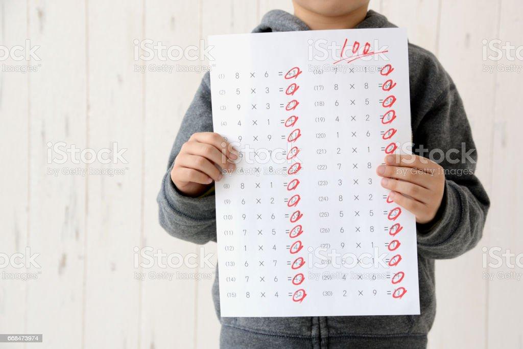 Boy having full score test stock photo