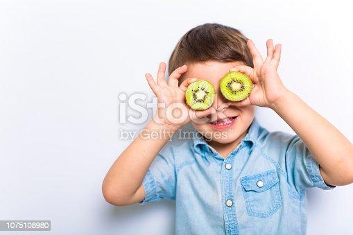 A Boy having fun on studio grey background
