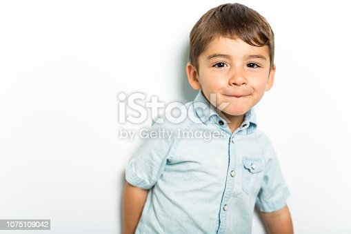 istock Boy having fun on studio grey background 1075109042