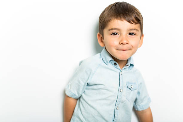 Boy having fun on studio grey background stock photo