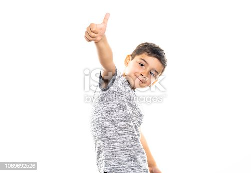 istock Boy having fun on studio white background 1069692526