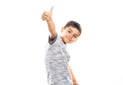 istock Boy having fun on studio white background 1069692526