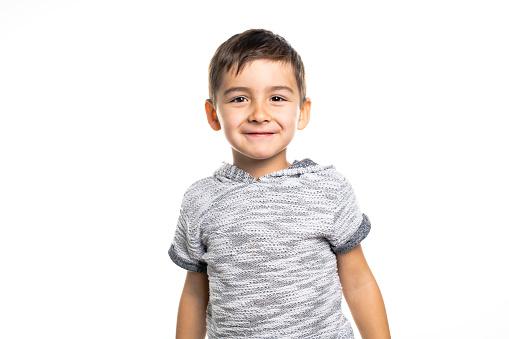 istock Boy having fun on studio white background 1069692528