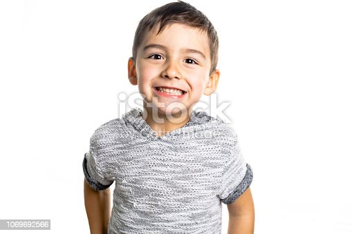 istock Boy having fun on studio white background 1069692566