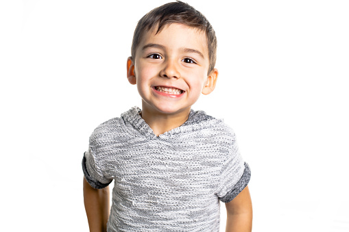 istock Boy having fun on studio white background 1069692566