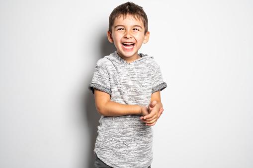 istock Boy having fun on studio white background 1069693268