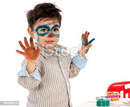 490853703 istock photo boy having fun with finger paint 150308016