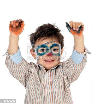 istock boy having fun with finger paint 150336795