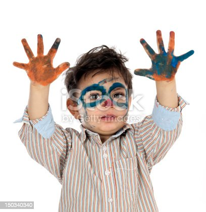 istock boy having fun with finger paint 150340340