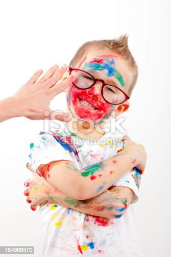 123499844 istock photo Boy having fun with finger paint 184909370