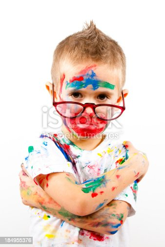 123499844 istock photo Boy having fun with finger paint 184955376