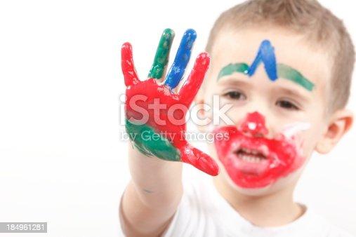 istock Boy having fun with finger paint 184961281