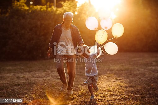 istock Boy having fun with grandpa 1004243460