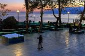 istock Boy having fun with skateboard. It's getting dark. sunset colors. 1199072235