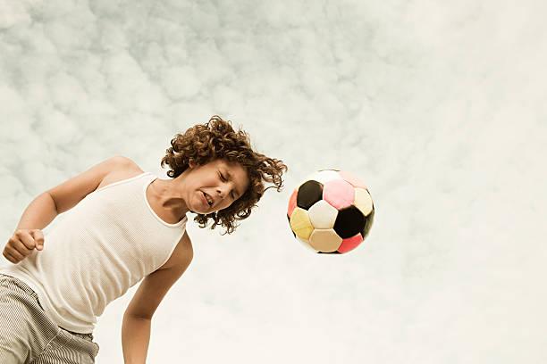 Boy heading football picture id109433590?b=1&k=6&m=109433590&s=612x612&w=0&h=g2 leotea3 t98powf2lfwixby4fwfv2qrjejwtysjc=