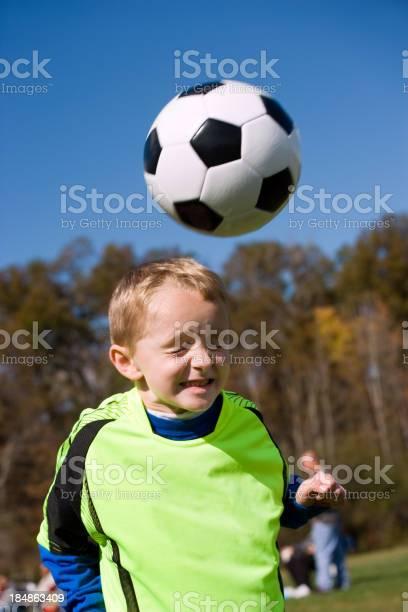 Boy heading soccer ball picture id184863409?b=1&k=6&m=184863409&s=612x612&h=u2n2dtks8 dfzbrbthosiatjsimejfe4w3txi9 zbrg=