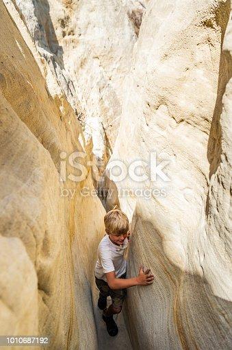 Boy Hiking Through A Canyon