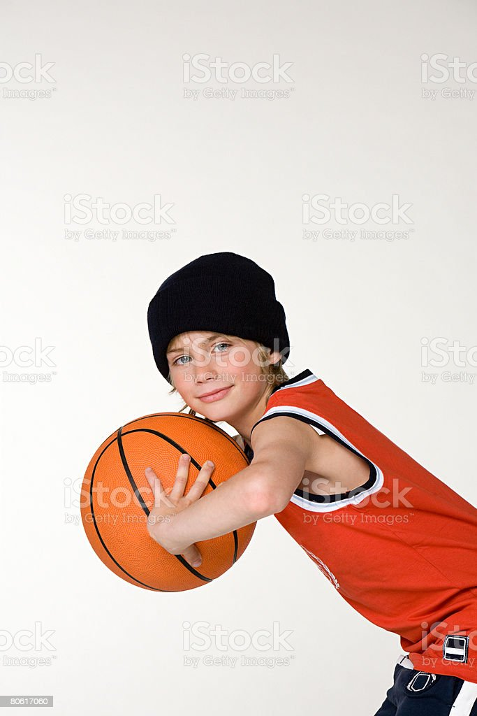 A boy holding a basketball royalty-free stock photo