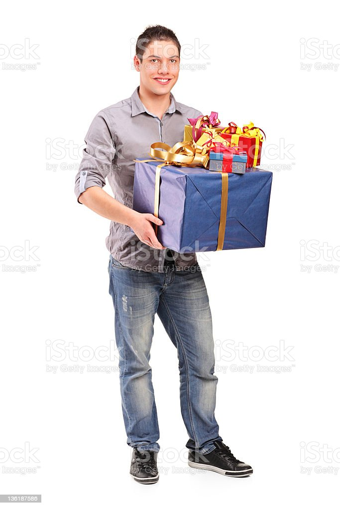 Boy holding a big gift royalty-free stock photo