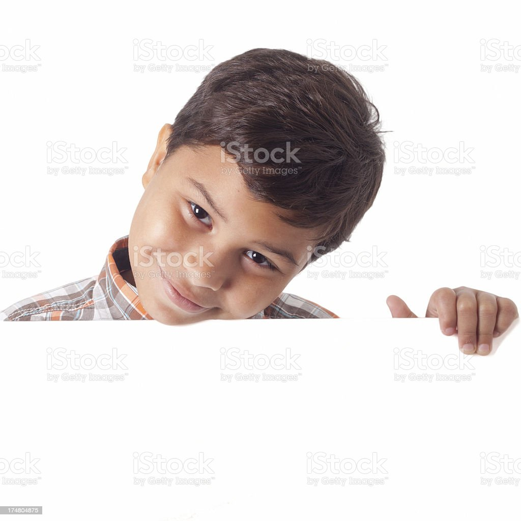 Boy holding a blank sign on white background royalty-free stock photo