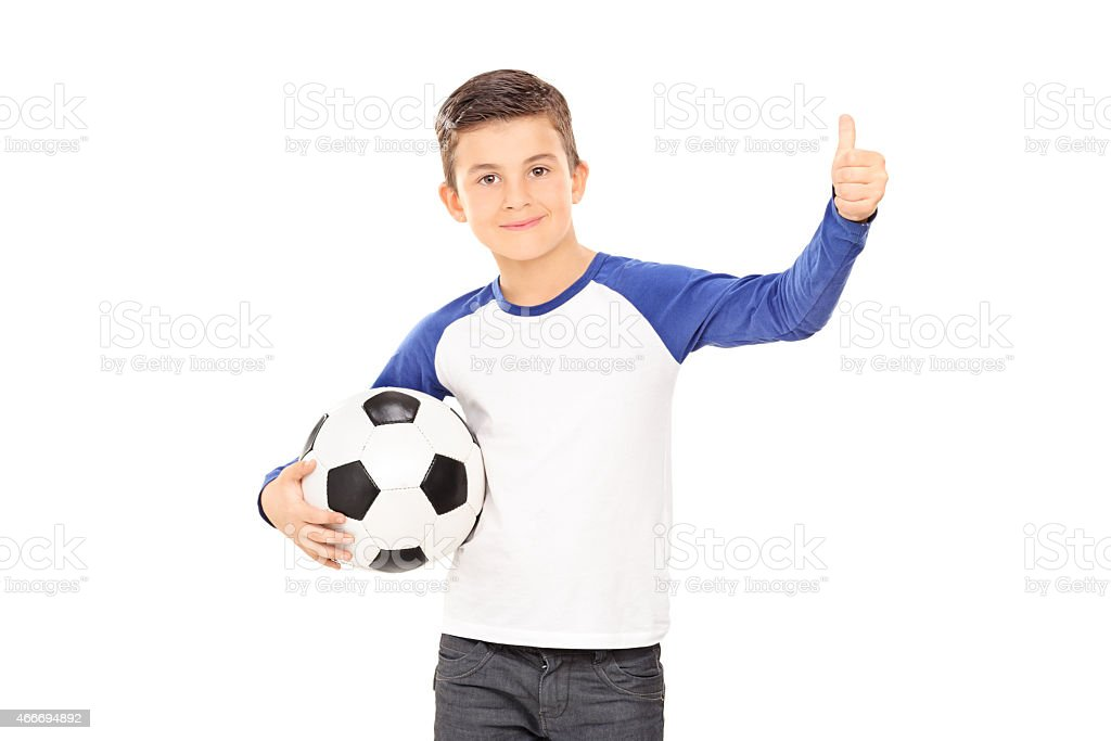 Boy holding a football and giving a thumb up stock photo