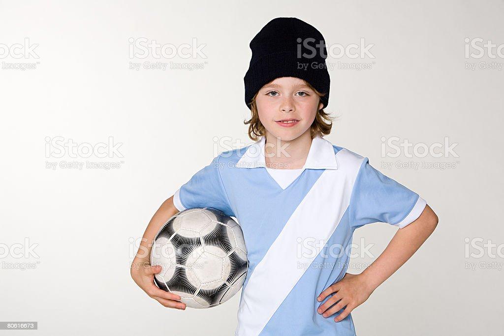 A boy holding a football 免版稅 stock photo