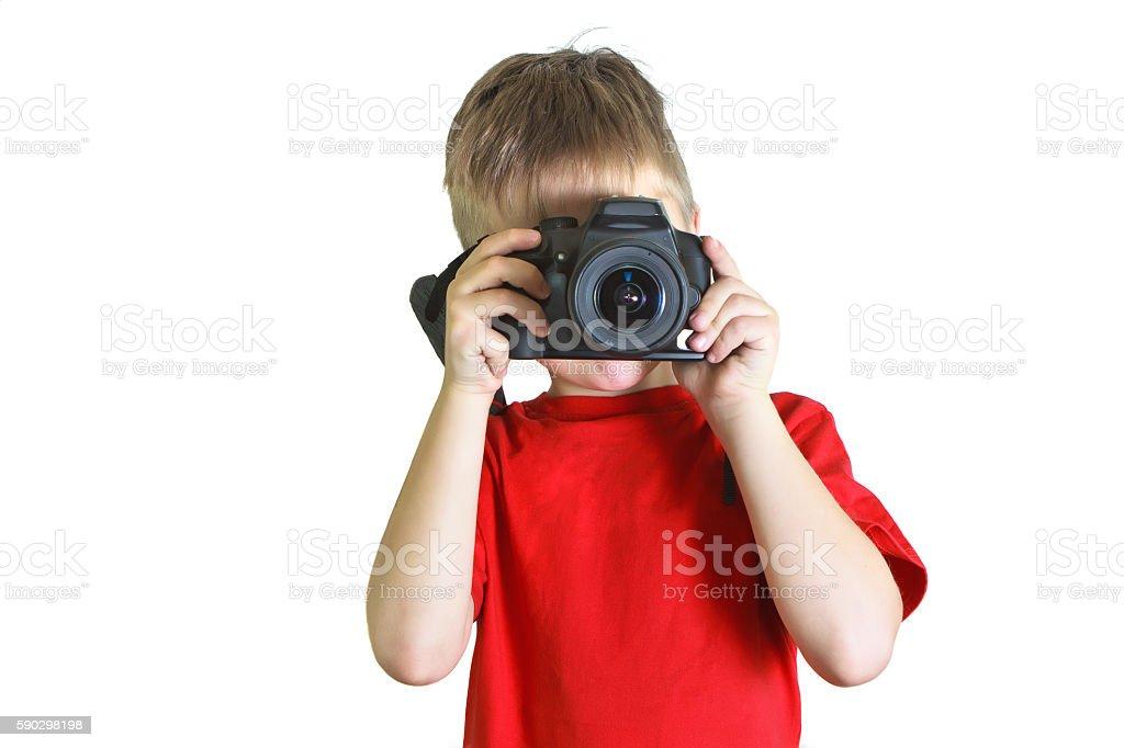 Boy holding a photocamera in front of him royaltyfri bildbanksbilder