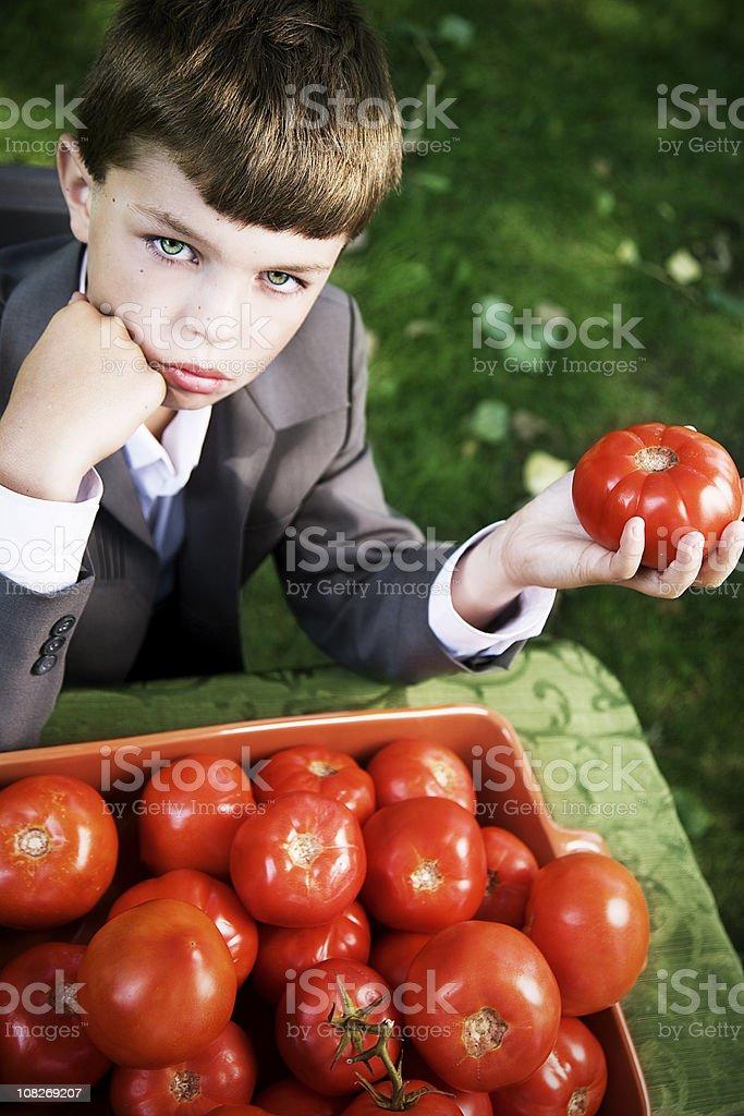 Boy holding a Tomato royalty-free stock photo