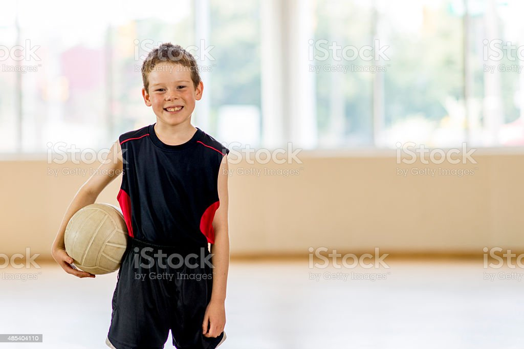 Boy Holding a Volleyball stock photo