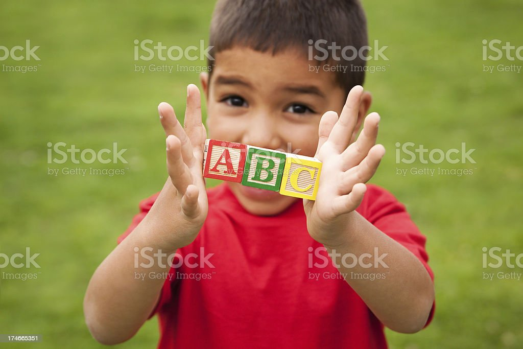 Boy holding ABC blocks royalty-free stock photo