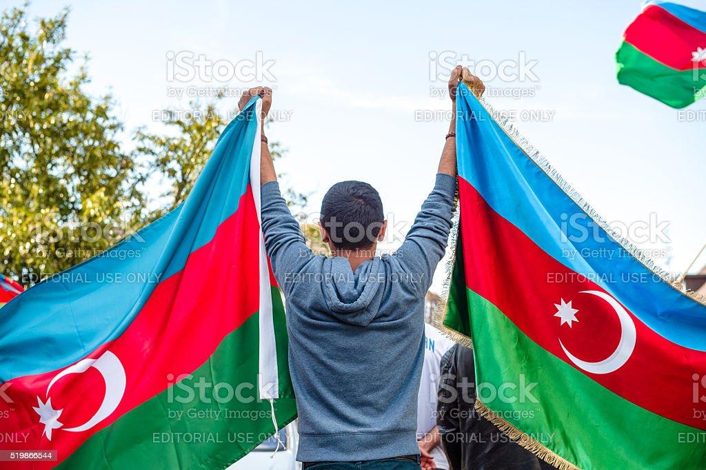 Boy holding Azerbaijan flags in  front of Armenian diaspora stock photo