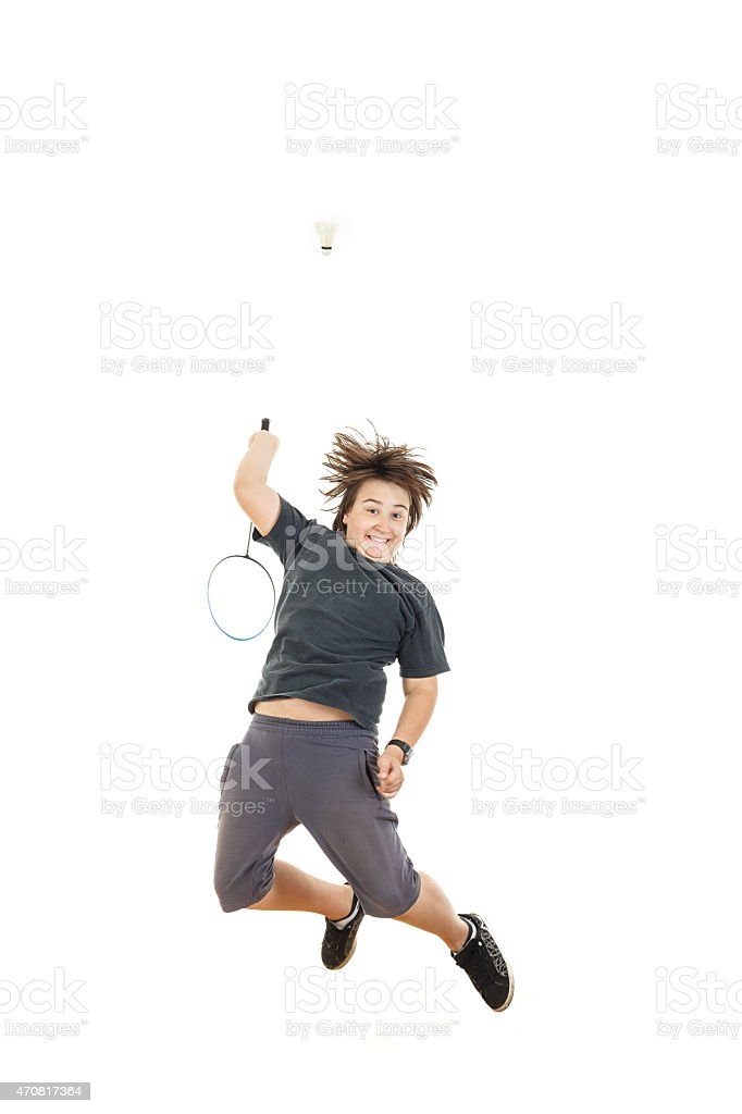 boy holding badminton racket and trying to hit ball stock photo