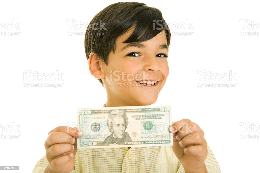 Boy holding banknote royalty-free stock photo