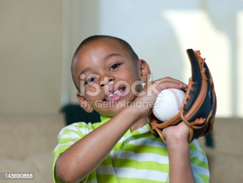 istock Boy holding baseball and glove 143690858